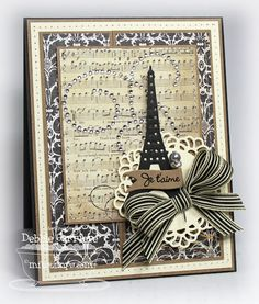 "Debbie Carriere: Scrappin' My Heart Out. Je t'aime card - 4-1/4"" x 5-1/2"" MFT Stamps: Who's that Parisian Girl. Papers: Lunch Bag Kraft cs, Kraft Outlet Buff Ivory cs, MME Lost & Found Two-Sunshine, Black licorice. Inks: Tsukineko Brilliance graphite black. Extras: Kraft Outlet Pewter Stick Pin; MFT die: Decorative Doily Duo, Eiffel Tower, Mini Wavy Pennants; Ribbon Carousel 3/8"" black & ivory striped grosgrain; CTMH sparkle flourish; sewing machine."