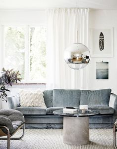 Winter Blues & Moody Hues | Winter Decor Inspiration | Dusty Blue Velvet Couch and Soft White Accents Give This Trend A Lighter Feel