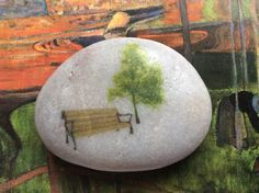 Park Bench and Tree on a natural polished river stone.