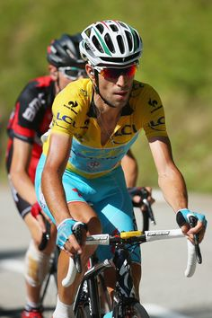 Race leader Vincenzo Nibali of Italy and the Astana Pro team in action on his way to winning the thirteenth stage of the 2014 Tour de France, a 197km stage between Saint-Etienne and Chamrousse, on July 18, 2014 in Chamrousse, France. (Photo by Bryn Lennon/Getty Images)