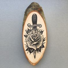 Wood slice with original drawing of a rose and door Inkspirednl