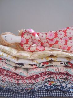 Princess and the Pea Set by Manda. A handmade Princess doll with 10 handmade, quilted mini mattresses and tiny hand felted green Pea. How adorable!