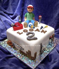 https://flic.kr/p/8G3o4m | Logan's 2nd Birthday cake ~ Handy Manny | I must confess I've never heard of Handy Manny but had to sit through an episode before I made this cake - it seems it's Disney version of Bob the Builder!.  The pliers and the saw are candles, I bought them an age ago as a set (there was also a hammer, screwdriver and wrench) it just so happened that I needed 2 candles and that the pliers and saw were the correct colours as per the characters in the show. All I needed to…