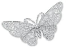 A DIAMOND BUTTERFLY BROOCH, BY TIFFANY & CO.   Designed as a pierced circular-cut diamond body, centering upon a bezel-set circular-cut diamond, extending openwork circular-cut diamond and wirework wings and bezel-set circular-cut diamond and knife-edged antennae, mounted in platinum  Signed Tiffany & Co., no. 23993295. [Edwardian or Edwardian style]