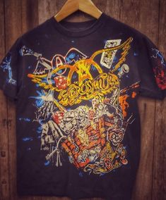 Aerosmith Vintage Band T Shirt 46 around the chest. If you need another size, send me a message and I will check.