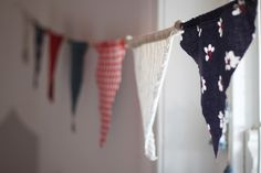 Nautical baby room, nautical boys bedroom, baby boy bedroom ideas, nautical baby room idea, blue baby room, blue baby boys room, how to decorate a baby room, anchors in baby room, navy and white baby room, bunting flags, red and white gingham fabric, bunting