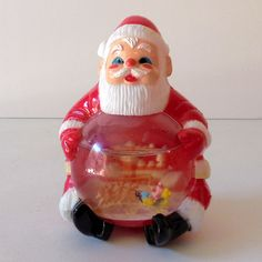 "Vintage Jolly Santa Clause Snow Globe Snowdome - Vintage 1960s-70, plastic Santa Claus figure. His ample belly is a snow dome with a scene of Santa in his reindeer drawn sleigh. The water is clear. The total height is 5&1/2 inches. It's in very good condition. The clear plastic dome has a couple of scuffs. Marked, ""Made in Hong Kong"". Z"