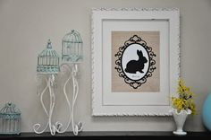 Add some spring to your decor with this wonderful Easter bunny silhouette printable on a burlap background!