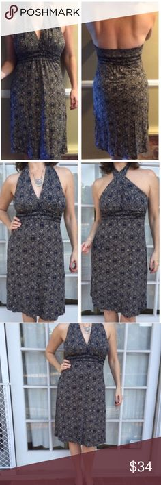 """BcbgMaxAzRiA halter navy blue Dress stretch SZ M Bcbg MaxAZRIA Flattering stretch halter dress in navy & beige intricate tribal pattern. Dual ways of tying - traditional halter or front criss cross. Pit to pit is 17"""" with LOTS of stretch. Cruise, vacation, pool side, resort, strolling around. Knee length (J2) BCBGMaxAzria Dresses Midi"""