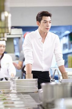 김우빈 looks so hot even when washing dishes. Is it the unbuttoned shirt? Rolled up sleeve? Or just him?
