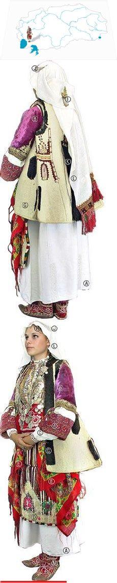 Ohridsko Pole bride,beg. of the 20th c Golema košula (bridal dress), Elek (shrt-slved jckt), Klašenik (vest); Pomaniki (lwr slvs); Grlinka & Grljuvče (frt pces); Skutina so bufki ( apron); Pridulnici (wool scarves); Struško šamivče (sash); Belo džube (slvless felt coat); Mangura, Gerdan, Čaprag (jewellery worn across the chest); Igla raskrstena, Ubetki (bridal jewellery worn on head);Sokaj (long head cover), Marama so vezba (emb white cotton scarf w/fringes); Alski čorabi so vetka (socks)