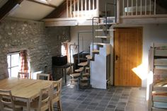 The Cow Shed at Penrhiw, Ceredigion. The living area and mezzaine in The Cowshed http://www.organicholidays.com/at/3468.htm