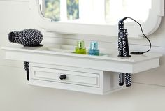 "the ""Getting Ready"" shelf from Pottery Barn. Room for hair care products and tools - plus your cords wont get tangled!"