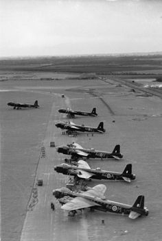 Oblique aerial photograph showing Short Stirling B Mark Is of No. 7 Squadron RAF, lined up on the perimeter track on the north-eastern side of the airfield at Oakington, Cambridge, for a night raid on Dortmund, Germany. Navy Aircraft, Ww2 Aircraft, Military Aircraft, Air Force Bomber, Heavy Cruiser, Air Festival, Ww2 Planes, Battle Of Britain, Royal Air Force