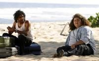 "Sayid and Hurley talk as he fixes the transceiver. (""Pilot, Part 2"")"