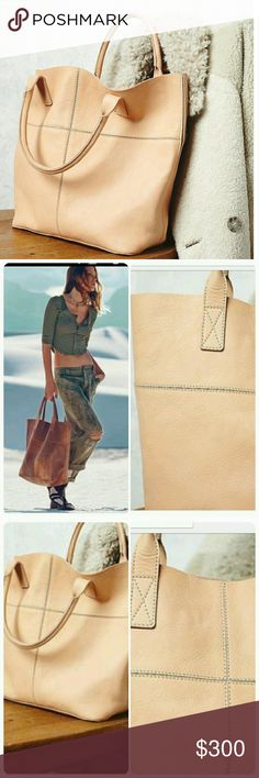 *NWT* Free people leather tote Natural raw pale tannish creme tone. Natural flaws in leather. 16 x 16  including handles. Legends of the fall, sold out Free People Bags Totes