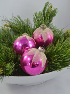 This offering is for a set of 3 vintage Shiny Brite glass ball ornaments with flocking. These great ornaments are a little bigger than the usual and in nice vintage condition. There is the expected bit of fading and color loss but no chips or cracks to the ornaments themselves.  They measure 2.75 inches in diameter.  I am happy to combine ship and refund shipping overages of $1.00 or more.  Thank you for looking! To return to my shop, please click below: www.etsy.com/shop/MichelleGr...