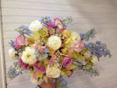 Pastel cascading bouquet by Boyds Blossoms
