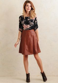Crafted in a rich camel-brown hue, this stylish faux leather skirt features a high-waist silhouette with a flared fit. Accented with stitch detailing and an exposed back zipper, this chic skirt...