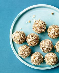 These sinless rice-pudding balls have a coating of toasted almonds and coconut, Wholeliving.com #healthy #desserts