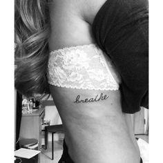 Breathe tattoo on the ribs