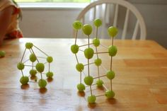Edible Art grapes and toothpicks. My kids definitely like to eat things on toothpicks. Can actually work on making shapes and then eat them!