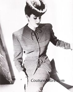 Just look at the geometric precision used in constructing this 1940s suit by Gilbert Adrian! A simple stripe fabric is cut and resewn at various angles. Each of the stripes is precisely matched in an intricate marvel of design