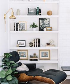 This #shelfie by @inspiredbylynne is a perfect mix of modern and traditional. I'd sit there for days! #simplystyleyourspace