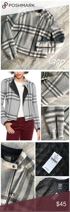 Gap nova check moto jacket Gap Grey nova check moto jacket. NWT @ $118. Never worn!  Material is 44% recycled wool, poly and acrylic. Lining is cotton quilted. Get the look of Burberry for way less. This is a small but could fit 6/8.  Measurements: When zipped 19 inches across the bust. 11 inches from underarm to bottom band of jacket. Sleeves measure 24 1/2 inches from shoulder to bottom. Bundle in my closet and save. I ship same day or next day almost always! Thank you for checking out my…