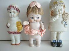 Bisque/porcelain three doll lot. $110.00, via Etsy.