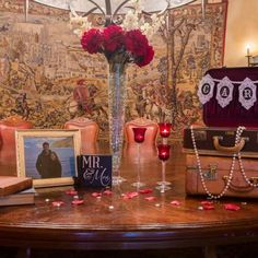 Welcome table complete with a guest book and suitcase style card box for wedding gifts.  | Brian Lorrigan Photography | villasiena.cc