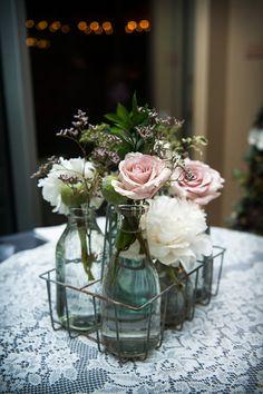 Flowers in bottles #centerpiece
