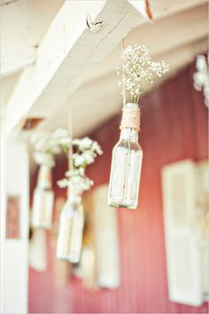 Baby's breath in glass bottles as wedding decor. Captured By: Stephanie Sunderland Photography ---> http://www.weddingchicks.com/2014/06/03/diy-your-wedding-in-a-field/