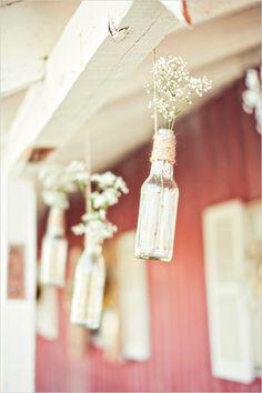 Baby's breath in glass bottles as wedding decor. Captured By: Stephanie Sunderland Photography ---> http://www.weddingchicks.com/2014/06/03/diy-your-wedding-in-a-field/