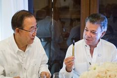 """Juan Manuel Santos Calderón (right), President of Colombia, gives Secretary-General Ban Ki-moon, a pen similar to the ones used to sign the Colombian Peace Agreement. The pens are made from recycled bullets and have inscriptions that read: """"Bullets wrote our past. Education, our future."""" UN Photo/Rick Bajornas"""