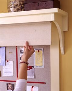 Friday Favorite Bulletin Board Idea - hang a roller shade under a shelf to hide visual clutter.