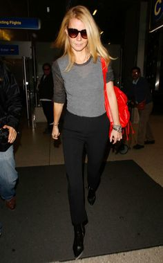 Gwyneth Paltrow arrived at LAX in high style! Check her out in oversized sunnies and a casually cool gray 'n' black get-up with a bright red bag!