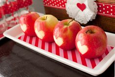 Apples with heart shapes carved on the side. Put citric acid (lemon, lime, orange juice) on shape to help it not turn brown.