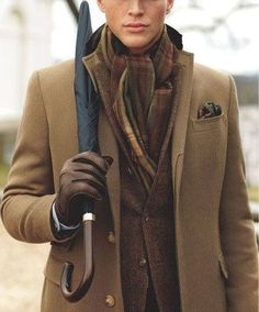 Shop this look for $322:  http://lookastic.com/men/looks/overcoat-and-blazer-and-pocket-square-and-scarf-and-gloves-and-dress-shirt/1696  — Brown Overcoat  — Dark Brown Blazer  — Dark Brown Pocket Square  — Dark Brown Plaid Scarf  — Dark Brown Suede Gloves  — White Dress Shirt