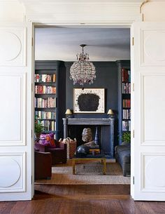 This moody space from Aerin Lauder's stylish New York City apartment always stops me in my pinning tracks. The entire Upper East Side abode is as chic as can be, but this room, which can be f… House Styles, Home And Living, Home Library, Home, Family Room, Living Spaces, Black Feature Wall, Home Decor, Room