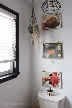 Decorating your bathroom? Skip finding perfect art and use this simple DIY tip. You can do this simple DIY with hangers, gold binder clips from Home Hoods and any magazine. Using vintage magazines adds tons of personality! (Sponsored pin)