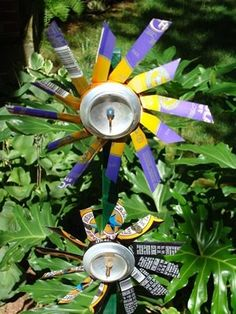 Soda Can Wind Spinners (I am SO making these, I've already made a bunch of other pinwheels but these ones are even cooler) Soda Can Crafts, Crafts To Make, Crafts For Kids, Diy Crafts, Garden Projects, Craft Projects, Projects To Try, Aluminum Can Crafts, Wind Sculptures