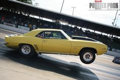 A first gen Chevrolet Camaro gets a good launch on the drag strip at Beech Bend Raceway Park in Bowling Green, Kentucky, during Holley's LS Fest