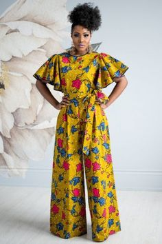 Be fun & flirty in the lovely Daia Afia Jumpsuit. This gorgeous outfit has piping in the neck and sleeve, a center back zipper, and lined bust. Find African print fashion at Kuwala. African Print Jumpsuit, Ankara Jumpsuit, African Print Dresses, Ankara Dress, African Dress, Robes Ankara, Ankara Gowns, African Fashion Designers, Latest African Fashion Dresses