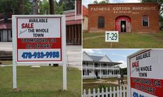 Town for sale, priced $2.5m: Community awakes to find signs on almost EVERY building as developer tries to hawk off historic area
