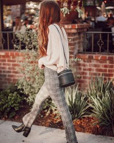 @jacimariesmith in our current favorite: the UO Cozy Plaid Kick Flare Pant. #UOonYou