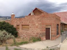 The old sandstone Bank of Amoretti, Welti, and Helmer in Dubois, WY.