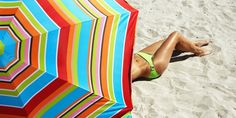 How does sitting under an umbrella match up to the power of sunscreen at the beach? The answer may be more shocking than you think.