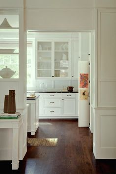 All About Hardwood Flooring + The Common Cleaner That'll Ruin Them! - laurel home | fabulous white kitchen by Donald Lococo Architects