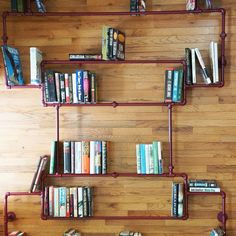This bookshelf made of pipes is such a cool idea
